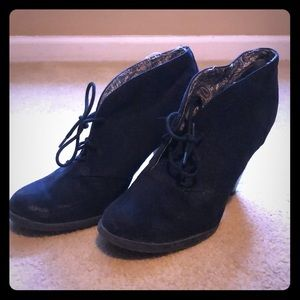 High heeled black booties!